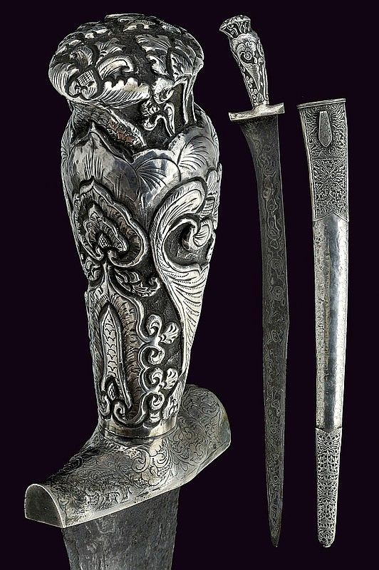 A silver mounted pedang, Indonesia, 20th century.
