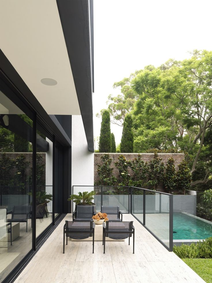 Tobias Partners - Cooper Park House.   Pool area and outdoor terrace in 'Roma' travertine from Artedomus.