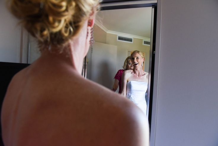 The bride discovering herself in the mirror | Janet & Matt | Wedding photographer | Beautiful white wedding dress