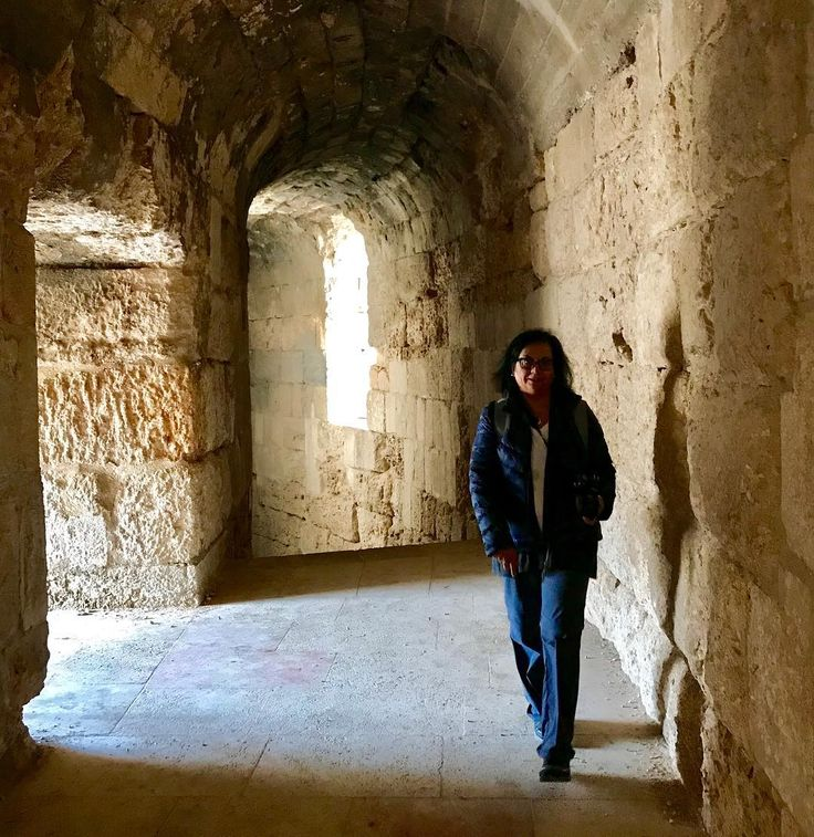 Exploring the beautiful Roman ruins in #jerash @visitjordan @myjordanjourney #photooftheday #photooftheday. Here Im wandering through the Roman Theatre.  jeradh is known for the ruins of the walled Greco-Roman settlement of Gerasa just outside the modern city. These include the 2nd-century Hadrians Arch the Corinthian columns of the Temple of Artemis and the huge Forums oval colonnade. Credit Google.