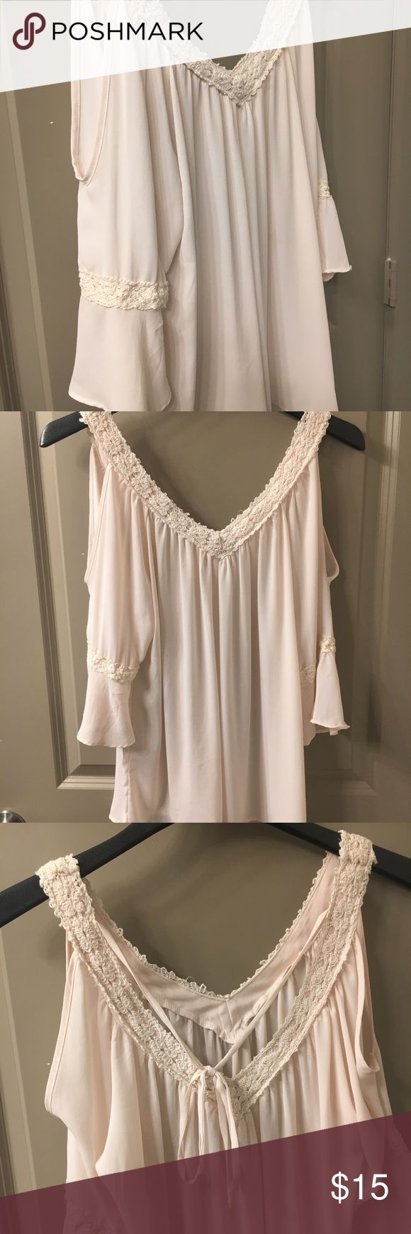 Cold Shoulder Flowy Bell Sleeve Blouse Has a crochet trim and strings to tie so you can adjust the size a bit. Charming Charlie Tops Blouses