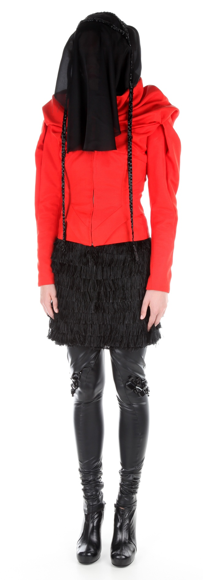Jacket ( cotton, polyester), veil ( silk chiffon, glass beads embroided onto a strap), dress ( silk threads), leggins ( polyester, precious stones), shoes ( leather, stainless-steel heel)
