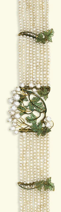 AN ART NOUVEAU PEARL AND ENAMEL CHOKER  The central curved panel designed with green plique à jour enamel foliage and natural pearl berry clusters to the nine-row pearl choker with foliate spacers and clasp, circa 1900, 31.5 cm long Accompanied by report No. 1/16023 dated 30 October 2008 from the AnchorCert Laboratory stating pearls to the front panel were found to be natural, extensive samples from the choker were found to be natural, with approximately 25 nucleated cultured pearls