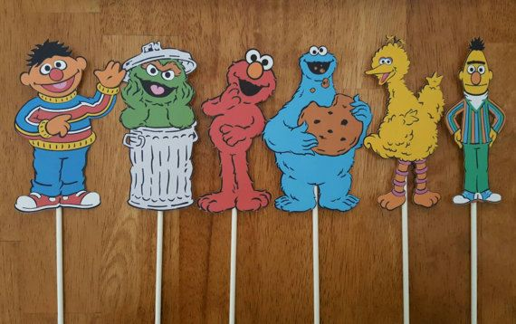 This listing is for 6 single sided Sesame Street themed cake toppers. You choose which characters you would like! Images are printed onto 110lb cardstock and measure between 5 and 6 inches tall and come attached to a 6 inch lollipop stick. Overall height is about 9.5 inches when
