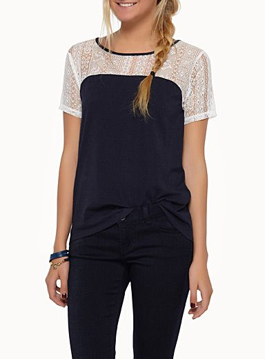 Simons, $19.99 $14.99 Style: 6955-13053, Exclusively from Twik     An openwork lace insert arranged in vertical bands on the top for a romantic touch   Soft stretch jersey in a cotton-modal blend   Loose fit for a relaxed style   Rounded, high-low hem   The model is wearing size small