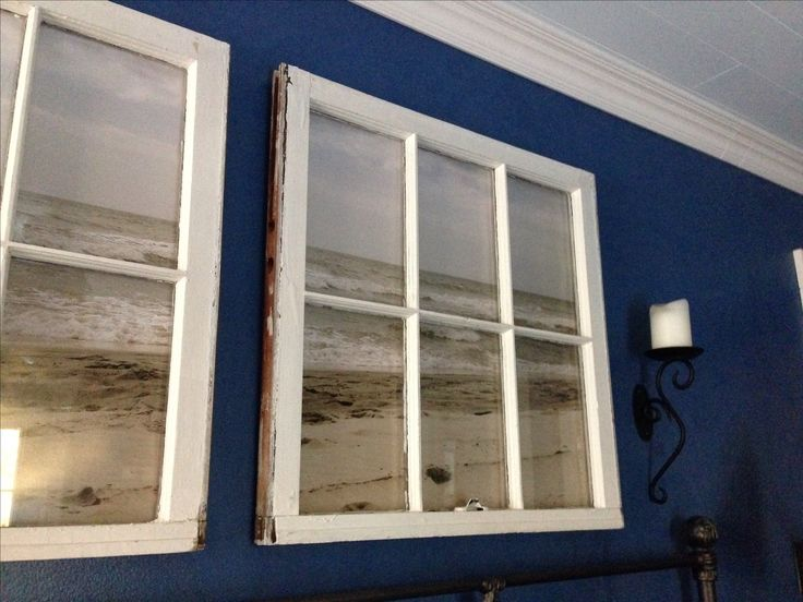 Make a poster from your favorite beach photo, or purchase a beach poster (or any outdoor theme you prefer) then frame it with an re-cycled window frame. Makes it appear that you are looking out a window. Love this clever idea!
