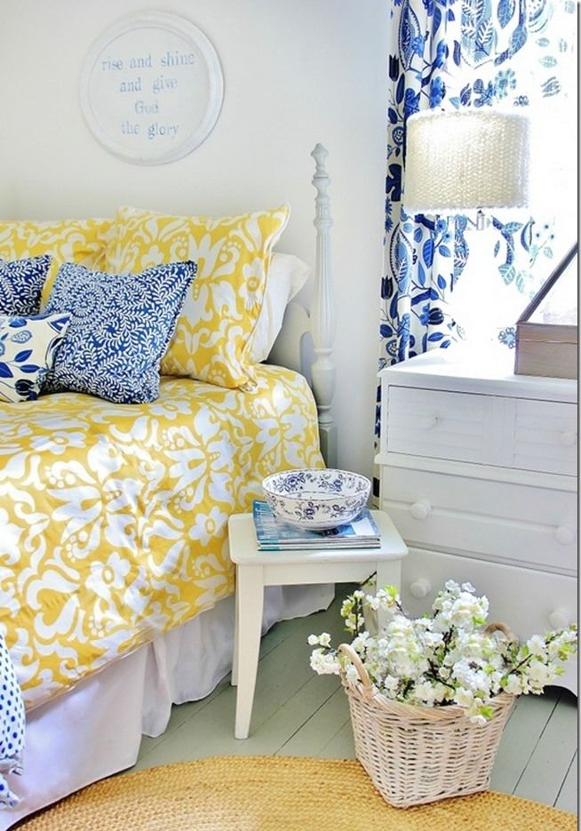 This country farmhouse bedroom by Thistlewood Farms is oh-so sweet with its cheerful yellow bedding and blue accents.