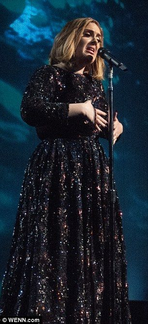 Woman of the moment: Adele showed off her slimmed down figure in a stunning sequinned blac...
