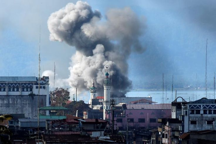 An explosion is seen after a Philippines army aircraft released a bomb during an airstrike as government troops continue their assault against insurgents from the Maute group in Marawi city. REUTERS/Jorge Silva