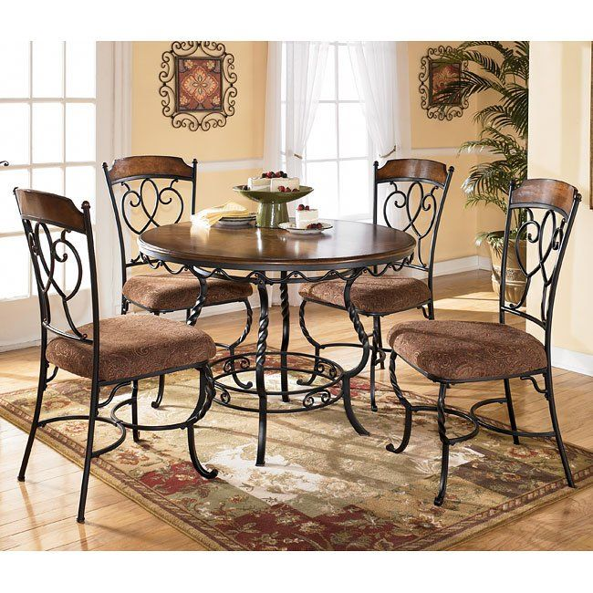 Nola 5 Piece Dinette Signature Design By Ashley In Casual Dining Sets The Scrolling Tradition Round Dining Room Round Dining Table Sets Kitchen Table Settings