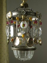 sweet way to upcycle vintage odds and ends into a chandelier