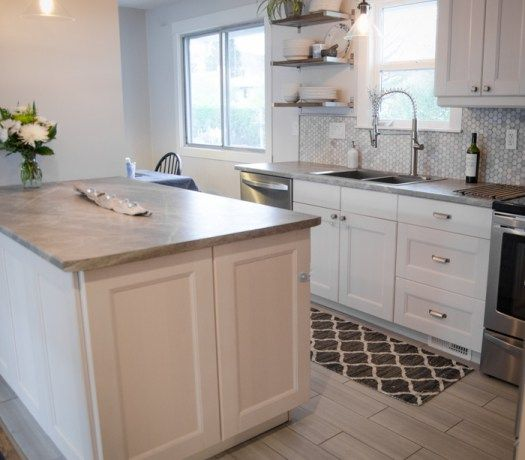 soapstone sequoia as kitchen countertops that are affordable.  Penny tile marble backsplash and white cabinets with tile floor, stainless steel appliances