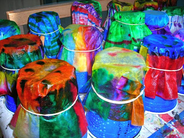 """Chihuly macchias- coffee filters watercolor markers with """"spots"""" on solid colors, rubber and to plastic cups, sprayed with heavy starch. When dry, attach to background for display."""