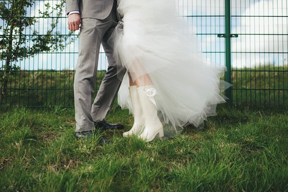 We love this picture: a bride in rain boots! Photo by http://www.sjoerdbooij.nl