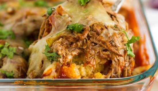 CARNITAS TAMALE PIE  2/3 cup all-purpose flour  1/2 cup yellow corn meal  3 tablespoons granulated sugar  1 tablespoon baking powder  1/4 teaspoon salt  2 tablespoons vegetable oil  1 can diced green chiles  1/3cup milk  1 egg  1 can cream corn  2-3 cups leftover carnitas  1 cup enchilada sauce  1 cup shredded white cheese (Jack, White Cheddar, Pepperjack, etc.)