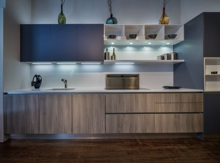 Cool colors and the perfect amount of recessed lighting create a relaxed feel in this modern kitchen.