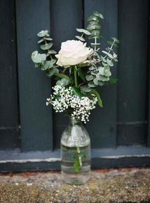 simple wedding centerpiece with eucalyptus, white rose, baby's breath