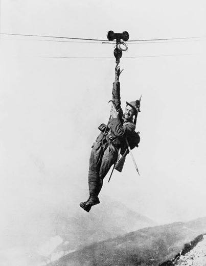 An Italian soldier using a zip line to locomove between one mountain and another, WW1