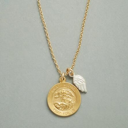 Small charms offer plenty to cherish on our delicate 'St. Michael' necklace.