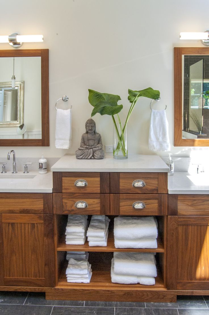 The Gardner/Fox team reconfigured the floor plan to accommodate a more spacious & luxurious master bath.  The newly revamped master suite incorporates a large walk in shower with 2 shower heads, a freestanding pedestal tub, and a makeup table with pendant lighting.