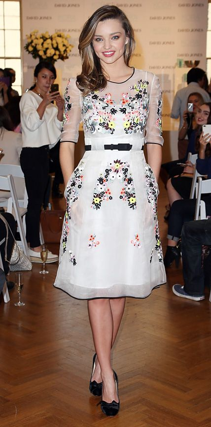 Miranda Kerr attended her Kora Organics event in Australia dressed in a floral embroidered silk-organza Erdem dress. Kerr anchored her look with black bow-topped pumps and a side-parted 'do.
