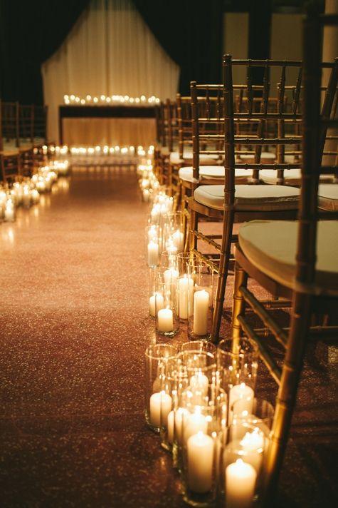 A romantic, candle-list aisle way   TheKnot.com