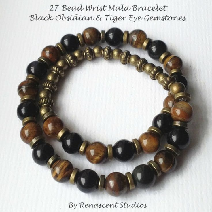 A new style of gemstone bracelet just released - Tiger eye & Obsidian bracelet for men that double wraps around the wrist. It's a 27 bead mala bracelet, great for meditation and style!