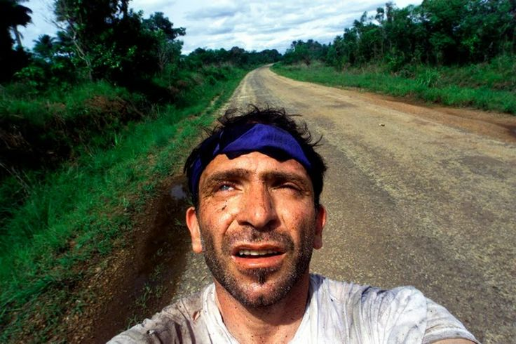 Yannis Behrakis Profile | The Wider Image | ReutersBehrakis takes a self portrait after surviving an ambush by Revolutionary United Front rebels in the jungle of Sierra Leone.  24 MAY 2000.	 SIERRA LEONE, AFRICA.