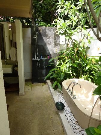 bathroom with an outdoor shower and tub