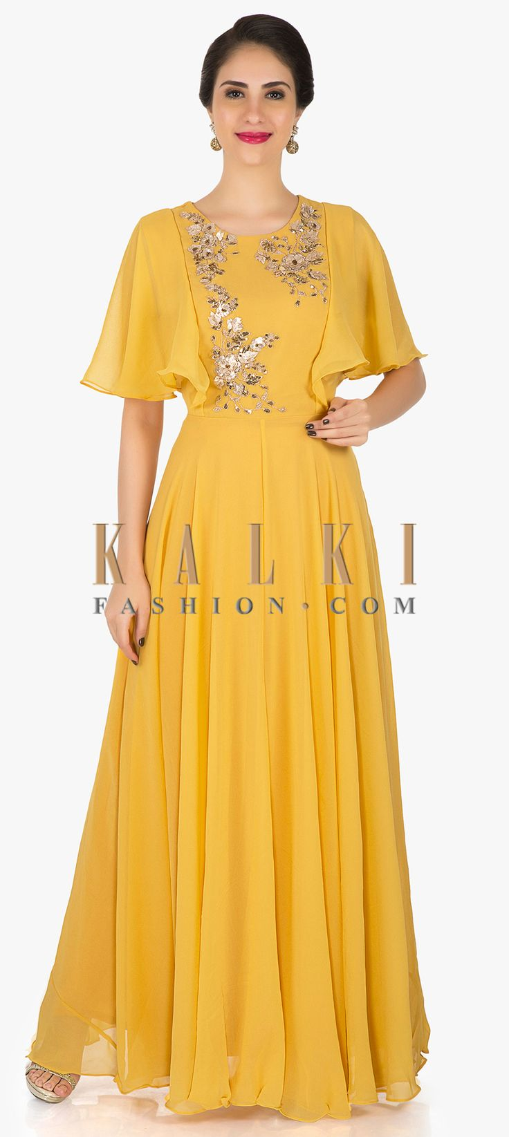 Mustard georgette anarkali gown embellished in zari and sequin work only on Kalki