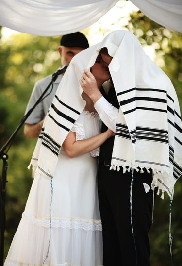 Jewish wedding- kissing under a prayer shawl - so sweet