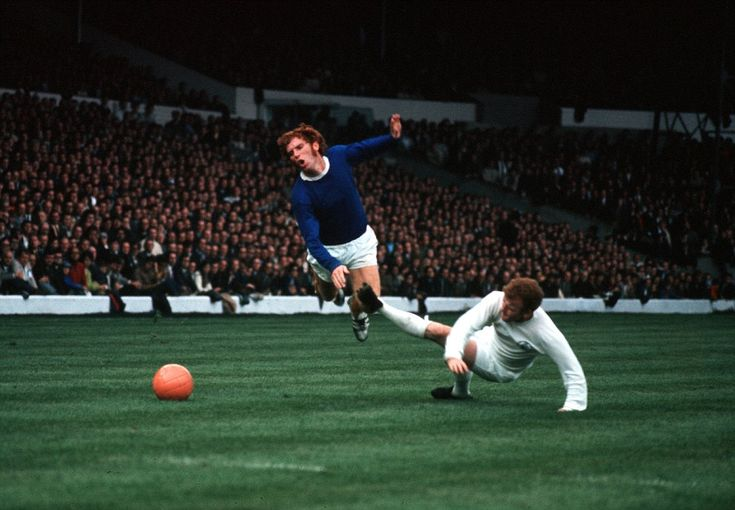 Billy Bremner Leeds captain, brings down Everton's Alan Ball (1945-2007) with a foul challenge from behind as Leeds United played Everton at Elland Road.