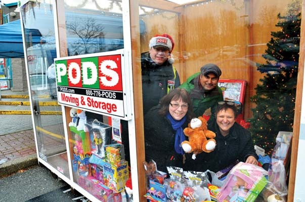 Come together: PODS Moving and Storage hosted a toy drive with Canlan 8Rinks in support of the Burnaby Christmas Bureau. Shown here are Mellanie Siteman, operations manager for PODs; Stacy McLean with 8Rinks; Don Springman with PODS; and the bureau's executive director, Stephen D'Souza.