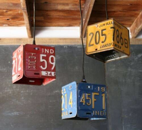 Pendant lights made from old license plates. I think I would use solid pipe down rods instead of bare wires to hang them.