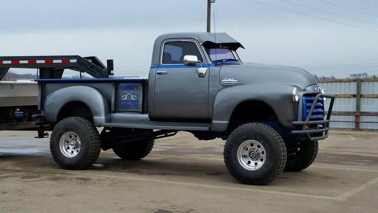 Chev Chevy Chevrolet Advanced Design GMC New Design pickup truck with chassis swap, massive lift, and pulling a 5th wheel trailer loaded with another chassis. Pic 2