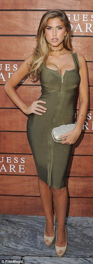 Stunning! Kara Del Toro squeezed her ample assets into an olive bodycon dress