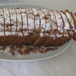 A sponge base is flavoured with apples, walnuts and cinnamon to create this great cake that is perfect to cut into thick slices and enjoy with a cup of tea or coffee.
