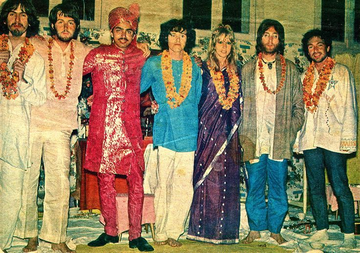 Exclusive Disc colour picture from India of the Beatles and friends at the Maharishi's meditation centre in Rishikesh. From left: George, Paul, Shah Jahan (who entertains the star guests), Donovan, Pattie Harrison, John and flautist friend Paul Horn.