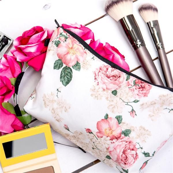 Vintage Rose Large Makeup Bag is Bigger than our pouches and is the perfect size travel or to organize your purse or backpack. 22 cm Across the Zipper 13.5 cm T