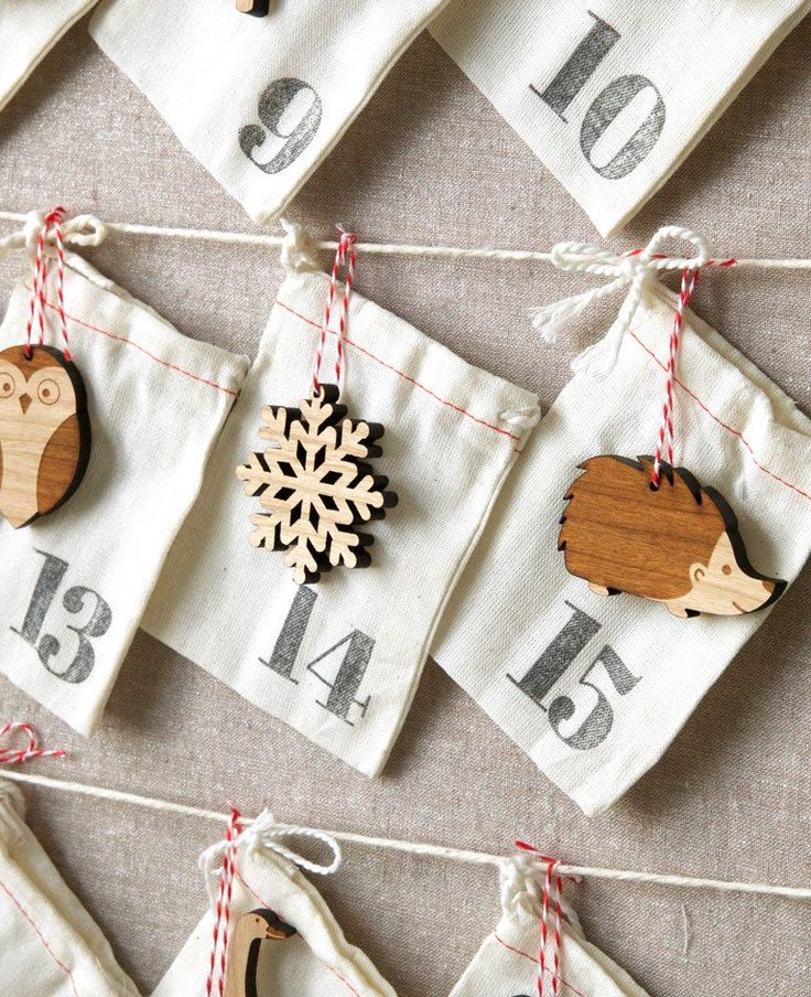Countdown to Christmas with the Through the Woods Advent Calendar. Featuring 25 hand-stamped cotton bags and 25 adorable wood ornaments, your entire family will be excited to see what each new day bri