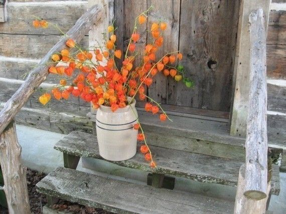 autumn - Simple but beautiful!! I can also see using an old-fashioned cream can in place of the butter churn. Love this.