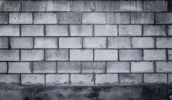 A blank grungy cinder block wall perfect for background and messages.