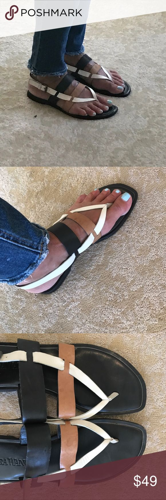 Vera Wang Annie Cream/Multi Sandal Size 8.5 Very good condition. When on your feet they look amazing. Close up you can see they show some wear. As picture show the front has a slight scuff. The tan has a few marks. Nothing terrible. Especially when worn. Honestly I have only worn these a few times. They are so comfortable. Black camel and white go with everything. I have original box. Purchased at Nordstroms. Perfect for today!! Vera Wang Shoes