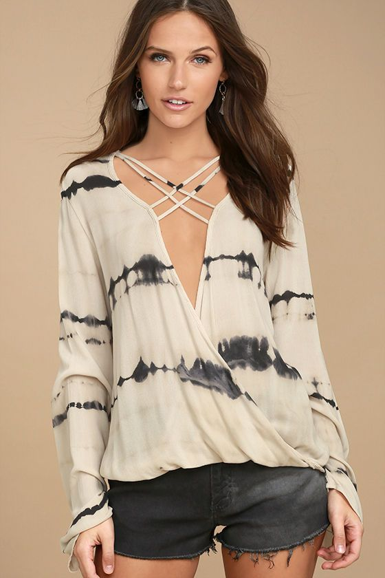 Go with the flow in the California Current Beige Tie-Dye Long Sleeve Top! Gauzy woven fabric with a beige and charcoal grey tie-dye print shapes a plunging surplice bodice with a strappy neckline and long bell sleeves. Rounded, high-low hem.