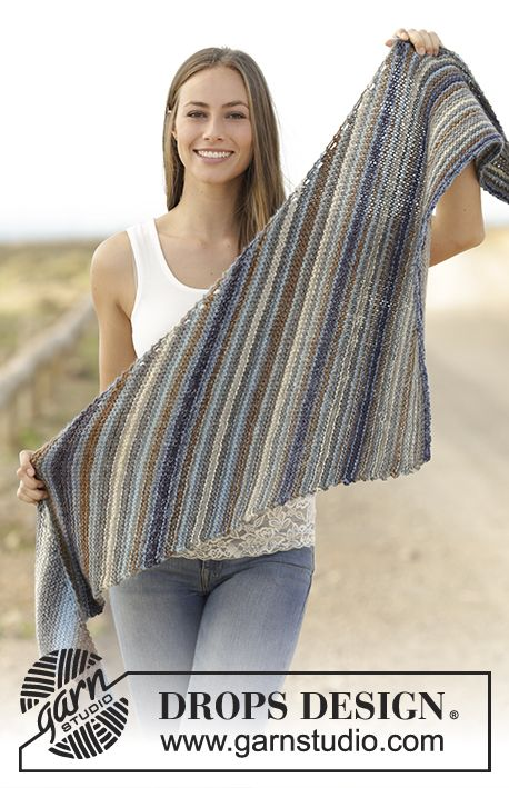 Knitted shawl in garter stitch in DROPS Big Delight. Free pattern by DROPS Design.