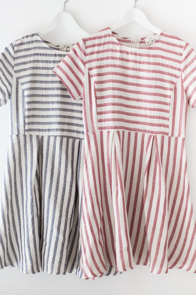 Striped short sleeve fit and flare dress. Made with high quality woven cotton…
