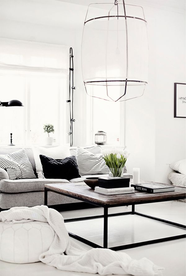 Your new apartment: A minimalist design | The best coffee tables home design ideas! See more inspiring images on our boards at: http://www.pinterest.com/homedsgnideas/home-design-ideas-coffee-tables/