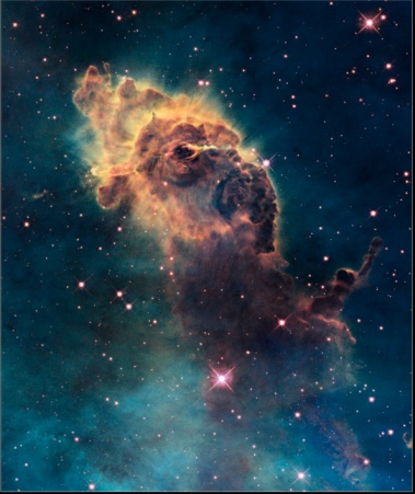 Young stars flare in the Carina Nebula. Credit: NASA/ESA. In the National Geographic Collection.