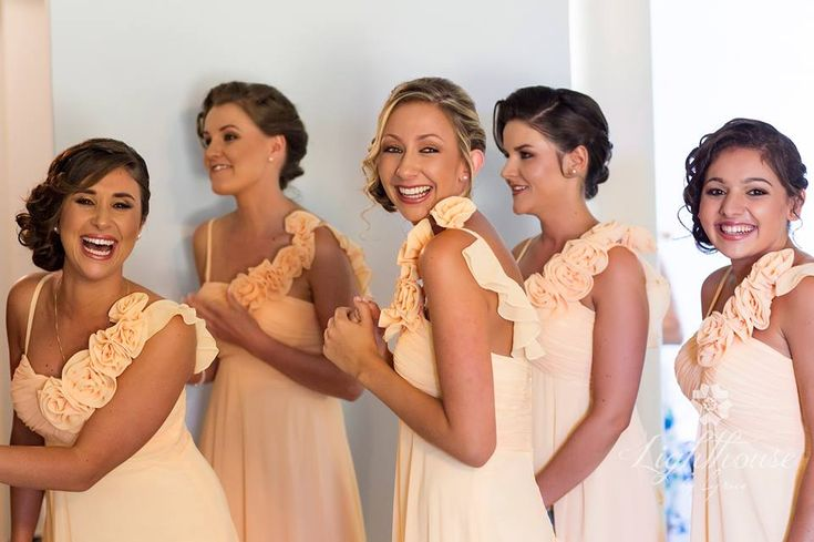 Gorgeous side buns curls & braids by Total Brides hair & makeup