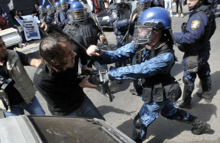 Paraguay news: School teachers clash with police during a march held as part of a national strike by the teachers in Asuncion, Paraguay